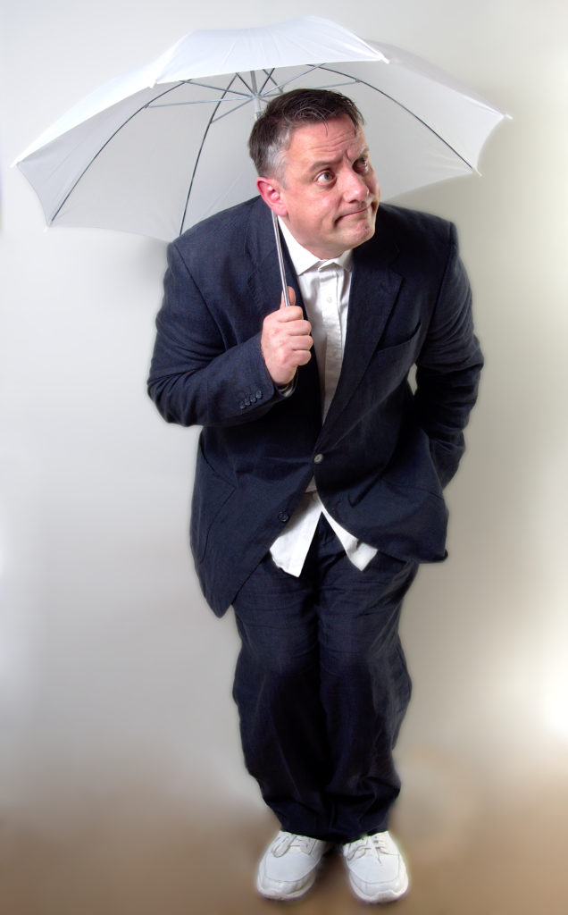 photo of a man sheltering under an umbrella against a white background