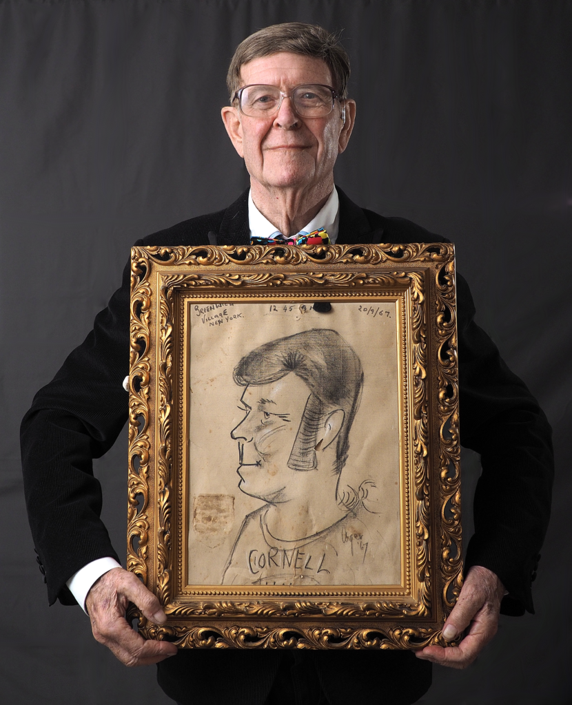 elderly man holding a picture