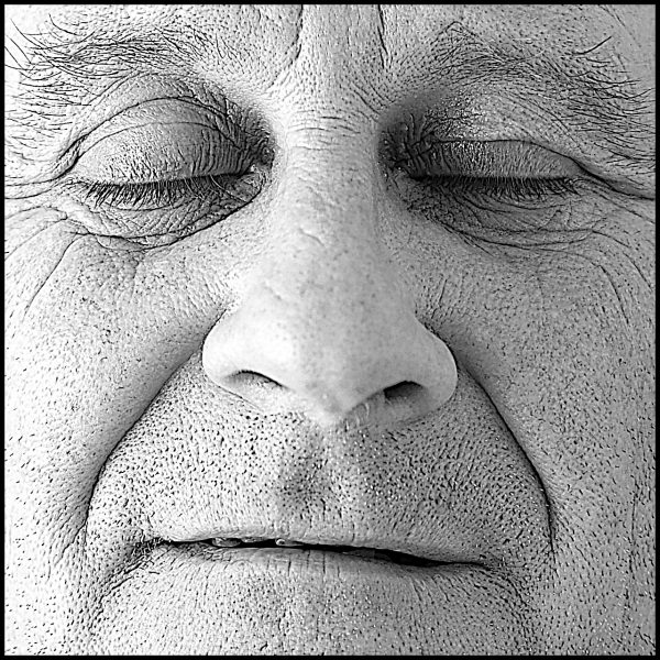 close up of man's face with wrinkles